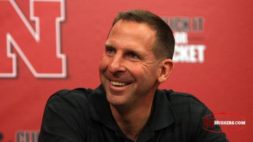 All smiles: Bo Pelini looks to have a more positive approach coaching a younger team this coming season.