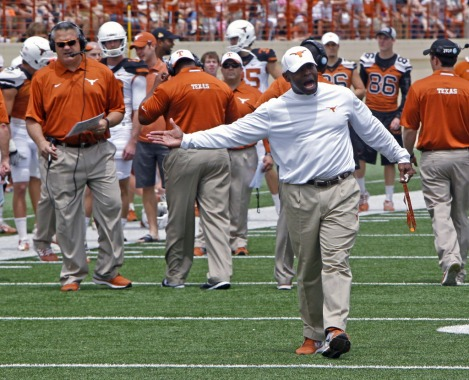 Coach Charlie Strong (right) has gone back to the basics at Texas, emphasizing the little things and leadership.