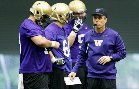 Chris Peterson (right) looks to bring his proven success to a Washington team looking to win the North in the Pac-12.