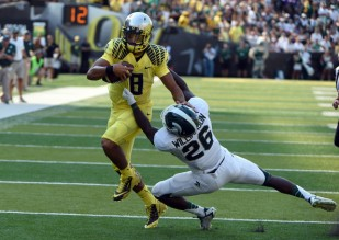 In Goat's Poll for Week 4, Mariota (left) and the Ducks are flying above the rest.