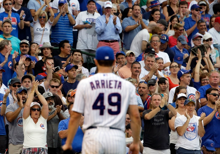 Chicago Cubs fans cheer for starter Jake Arrieta (49) during the sixth inning of a baseball game against the San Francisco Giants, Sunday, Aug. 9, 2015, in Chicago. (AP Photo/Nam Y. Huh)
