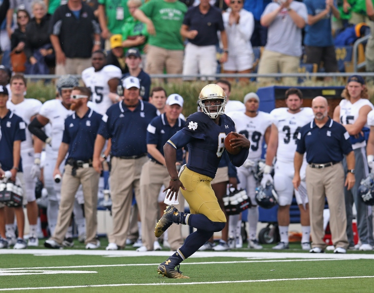 SOUTH BEND, IN - AUGUST 30: Malik Zaire #8 of the Notre Dame Fighting Irish runs 56 yards on his very first collegiate play against the Rice Owls at Notre Dame Stadium on August 30, 2014 in South Bend, Indiana. Notre Dame defeated Rice 48-17. (Photo by Jonathan Daniel/Getty Images)