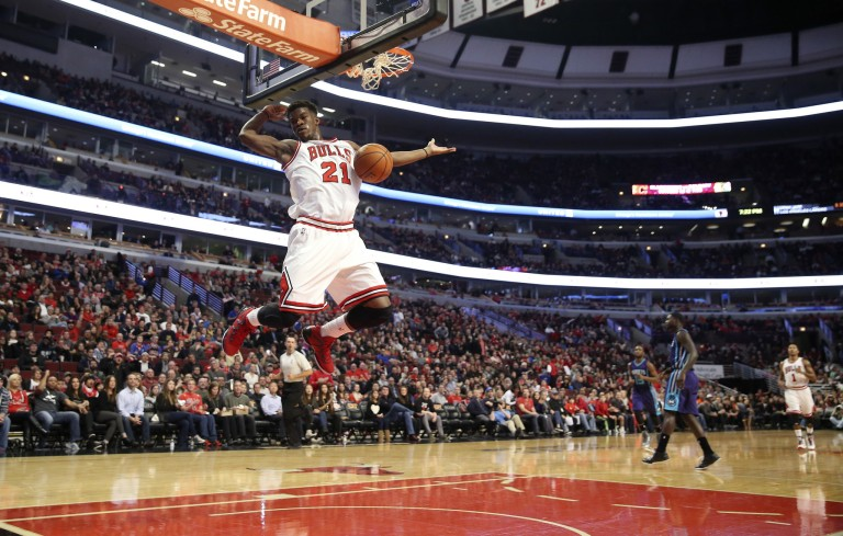 Chicago Bulls guard Jimmy Butler (21), dunks against the Charlotte Hornets, during the first half of their game at the United Center, in Chicago, on Sunday, Oct. 19, 2014. (Nuccio DiNuzzo/Chicago Tribune)