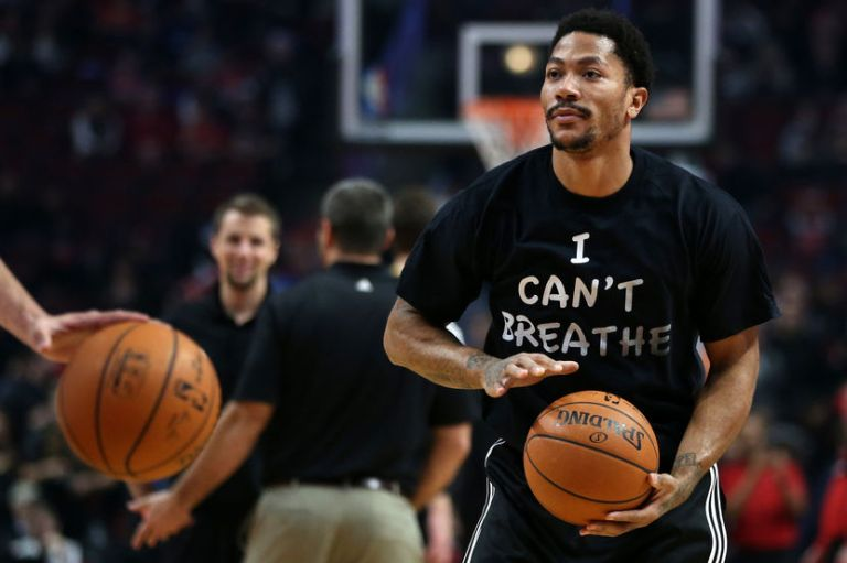 Dec. 6, 2014 - Chicago, IL, USA - Chicago Bulls guard Derrick Rose wears a shirt reading ''I Can't Breathe'' while warming up for a game against the Golden State Warriors on Saturday, Dec. 6, 2014 at the United Center in Chicago. (Credit Image: © Chris Sweda/TNS/ZUMA Wire)